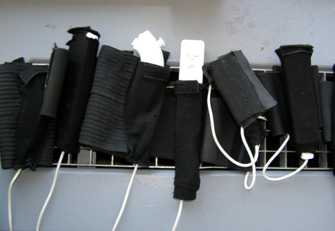 W_space: On the Wall: The Wiimotes and Nunchuk attachments fit into elastic sleeves. Photo courtesy of Tom Tlalim
